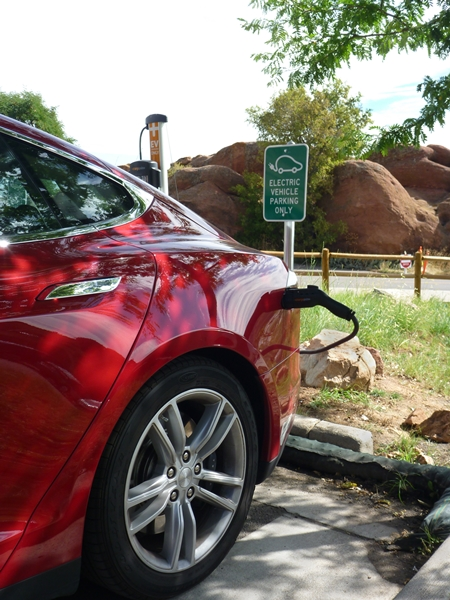 electric vehicle's batteries get a charge from a Chargepoint charging station while parked at the Red Rocks Park and Ampitheater parking lot in Morrison, Colorado.